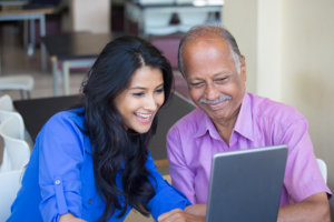 caregiver and patient using tablet